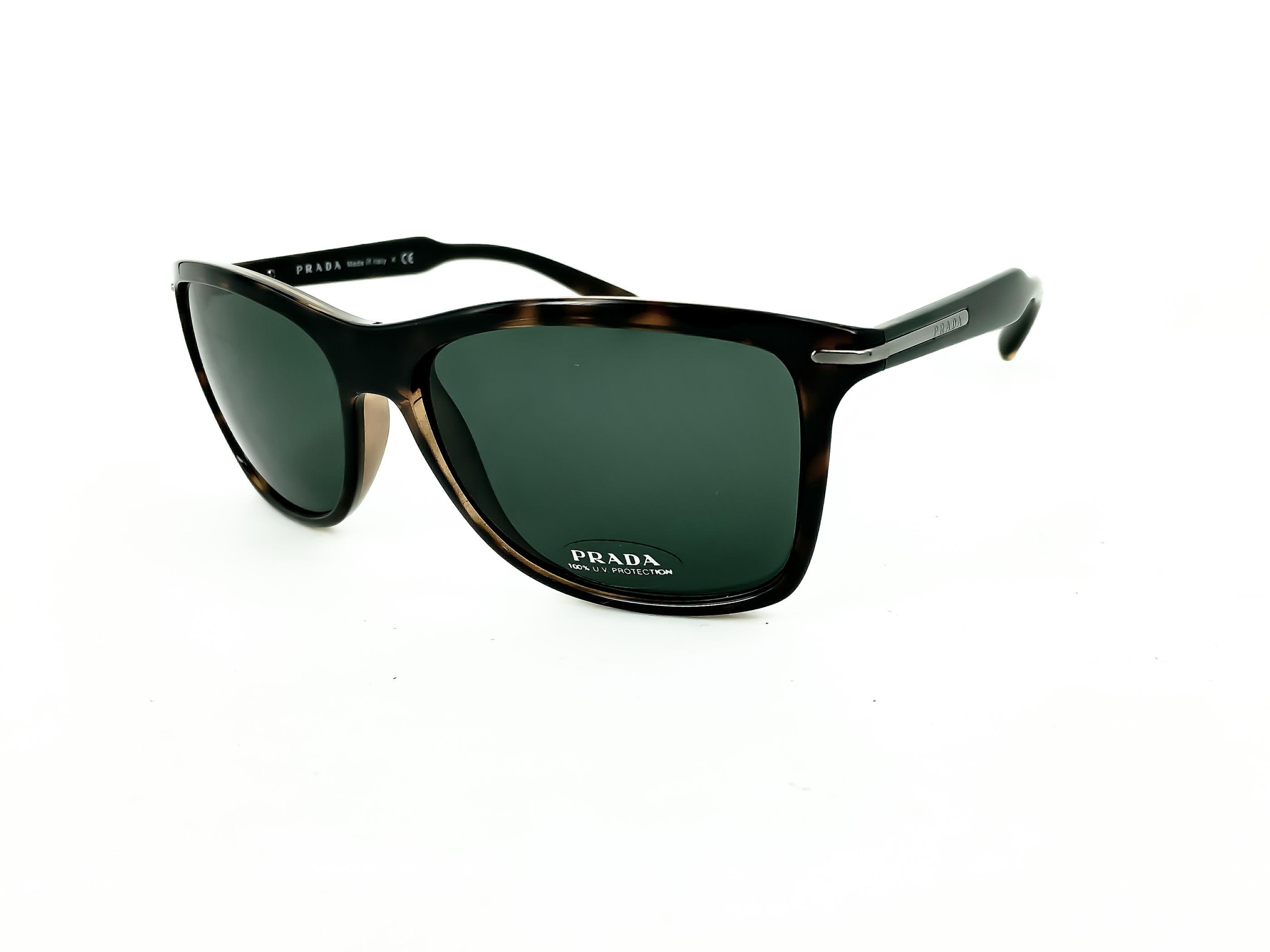 778ed4e422 Τα γυαλιά ηλίου PRADA SPR 10O 2AU-3O1 έχουν καφέ κοκάλινο σκελετό σε  τετράγωνο σχήμα